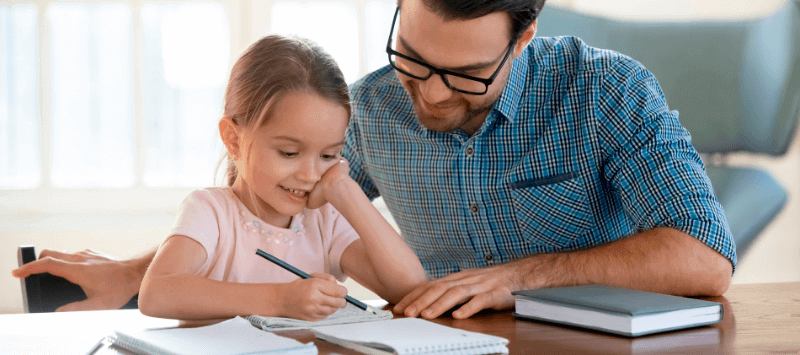 a parent helping a child with their homework